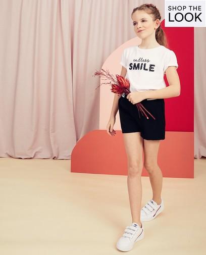 Votre tenue est complète avec un sourire